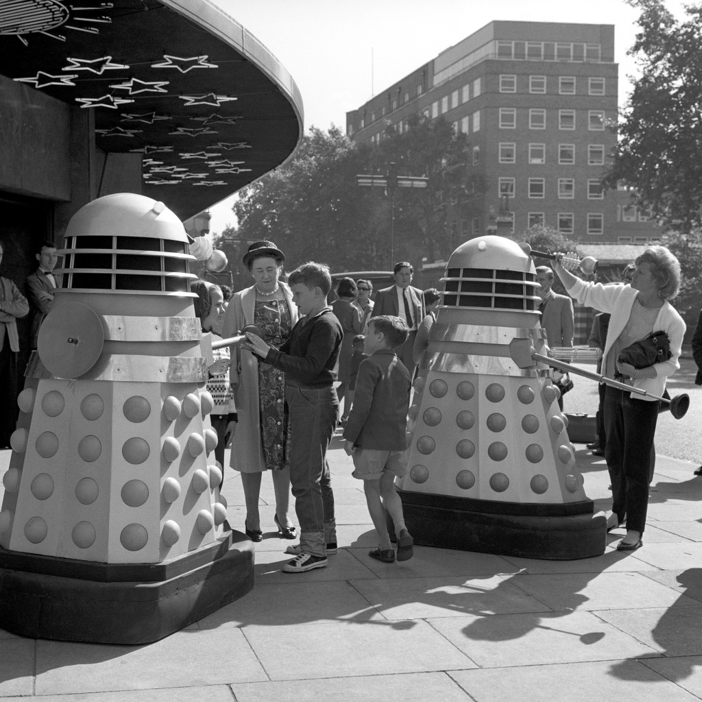 Children meeting robot Daleks outside the Planetarium, Baker Street, during location shooting for a new series.